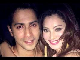 Varun Dhawan and Urvashi Rautela were spotted getting cosy with each other at a popular celebrity hangout on Thursday night after the India-West Indies match...
