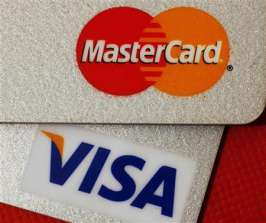 (Reuters) - Visa, Mastercard and a group of retailers plan to ask a judge this week to approve a landmark settlement of a lawsuit over credit card fees, setting the stage for a battle with Wal-Mart and hundreds of other merchants who say it is a bad deal.