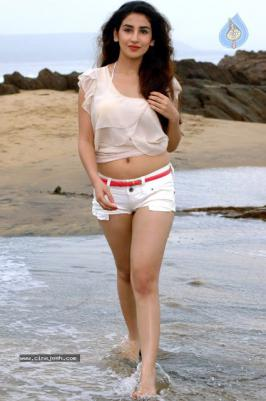 Parul Gulati in tiny shorts at beach Latest hot shoot stills. Gorgeous young actress Parul Gulati, who appeared in Tv programs (Kitani Mohabbat Hai - 2, Yeh Pyaar Na Hoga Kam) and in Bollywood movies. Recently she has done a Punjabi movie called Bura