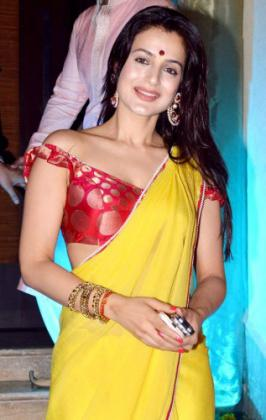 Amisha Patel in Desi Dress Yellow Saree with a Bengali Style Red Blouse | EXGLAM