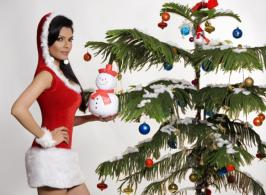 As if readying herself for the cover of the world's most famous men's magazine Playboy and bagging a role in Rupesh Paul's international motion picture Kamasutra 3D wasn't enough, Sherlyn Chopra donned a Santa Claus costume to gift and entertain street kids and underprivileged children this week.
