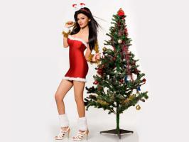 Sherlyn Chopra donned a Santa Claus costume to gift and entertain street kids and underprivileged children this week.