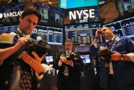 US stocks surged in the first trading session of the new year, rising sharply after lawmakers reached a last-minute budget accord to prevent huge tax rises and spending cuts. The S&P 500 climbed 1.8 per cent to 1,451.38 by midday in New York. The