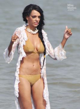 Judi Shekoni shoots in Mumbai Wearing a skimpy gold bikini with a lace cover-all, actress Judi Shekoni was spotted shooting a dance sequence on a beach in