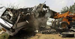 A school bus collided with a truck laden with bricks in northern India on Monday, killing 12 children and their driver, police said.