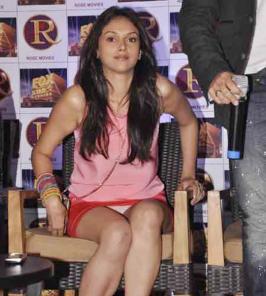 Aditi Rao Hydari had an oops moment when her lacy white panty showed under her micro mini bright orange skirt.