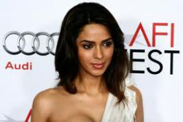 "According to the B.Town news mallika sheravath has attended her new reality show launch - Bachelorette India at reporter's center she said ""I think in Bollywood, Karan Johar is a perfect bachelor and for more read only on movies.infoonlinepages.com"