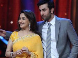 Ranbir Kapoor says he is so besotted with actress Madhuri Dixit that he cajoled his director Ayan Mukerji to let him kiss her on cheeks.