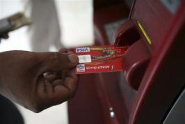 A breach of security at two payment card processing companies in India that led to heists at cash machines around the world has reopened questions on the risks of outsourcing sensitive financial services to the Asian nation.  Global banks that ship work to be processed in India, either in-house or to big IT services vendors, were already under pressure to step up oversight of back-office functions after a series of scandals last year.
