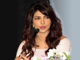 Priyanka Chopra has slammed Mallika Sherawat for criticing India at 66th Cannes film festival and calling it a depressing.