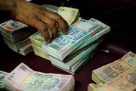 The rupee gives up some gains to trade at 58.30/31 to the dollar from 58.21 before the data release