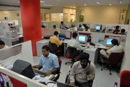 Indian IT companies hope to pass on some of the benefits from a weak rupee to their clients, but worry immigration reform could hit business.