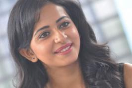 Rakul Preet Singh New Photo Gallery . Rakul Preet Singh New Photos Gallery,  Venkatadri Express movie heroine Rakul Preet Singh latest photo stills  at film pressmeet. Kannada actress Rakul Preet hot photos in skirt .