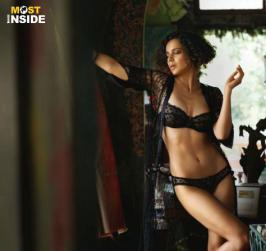 Bollywood Actress Kangana Ranaut sizzled in Photo Shoot for GQ magazine. She wore black lingerie. Check out the sizzling poses of Kangana.