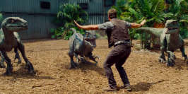 If the last trailer was meant to set up the story of the long-awaited sequel, this new trailer brings the focus to the action. We see exploding helicopters, dinosaur corpses and Chris Pratt taming a group of raptors all within 2 and a half minutes. If you thought that the studio might scale back for the 2015 entry into the Jurassic Park series, you were sorely mistaken. <br/> <iframe width=