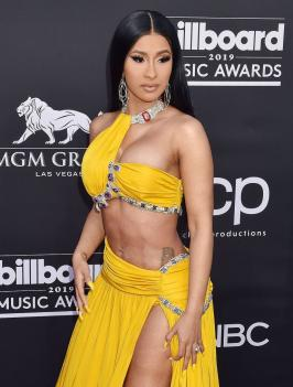 Cardi B Shows Off Her Insane Abs In Yellow BBMAs Dress Cardi B wows in a yellow dress on the red carpet kissing with Offset at the 2019 Billboard Music Awards