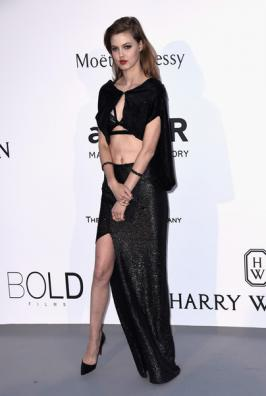 Lindsey Wixson turned heads when she arrived in this belly-baring creation.Lindsey Wixson poses as she arrives for the amfAR 22st Annual Cinema 2015