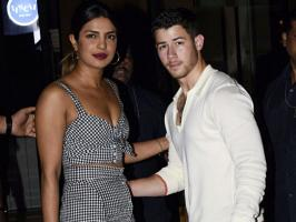 Bollywood actress Priyanka Chopra spotted with her rumored Boyfriend Nick Jonas at her new house warming ceremony ceremony in Mumbai. The young couple step out for dinner with Priyanka mother Madhu Chopra.