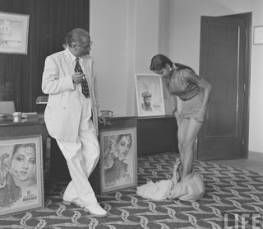 Photographs of Hindi movie director A R Kardar of Kardar Productions taking screen test of new girls for his movie in 1951. A R Kardar (Abdul Rashid Kardar) was director of famous movies like Shahjehan (1946), Dillagi (1949), Dulari (1949), Dil Diya Dard Liya (1966) etc. These photographs were taken by James Burke for Life Maga