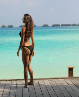 Disha Patani now flaunts her $exy body in a black bikini by the beach. Disha Patani Black Bikini, Disha Patani Hot Latest Bikini Photos, Disha Patani Latest Bikini Photos