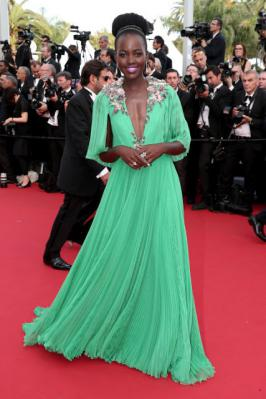 Lupita Nyongo exposing cleavage in  Cannes 2015 in Green Dress