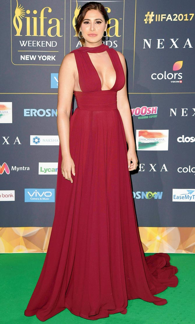 Nargis Fakhri Shows ample cleavage in this outfit
